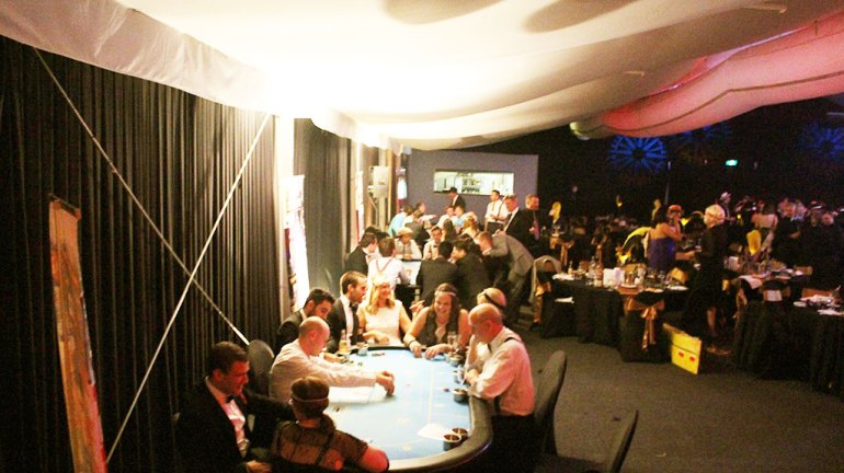 Poker tables at a fun casino night