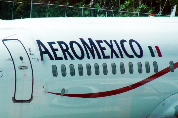 Aeromexico Passengers Airplane Packed At Cancun International Airport Close Up View. Mexico