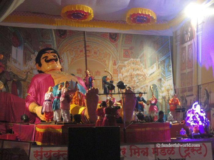 Stories from the Ramayana: Waking up Kumbhakarna. Ganesh Chaturthi, Pune, Maharashtra, India.