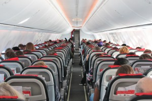 Airplane cabin aisle with rear view and seats