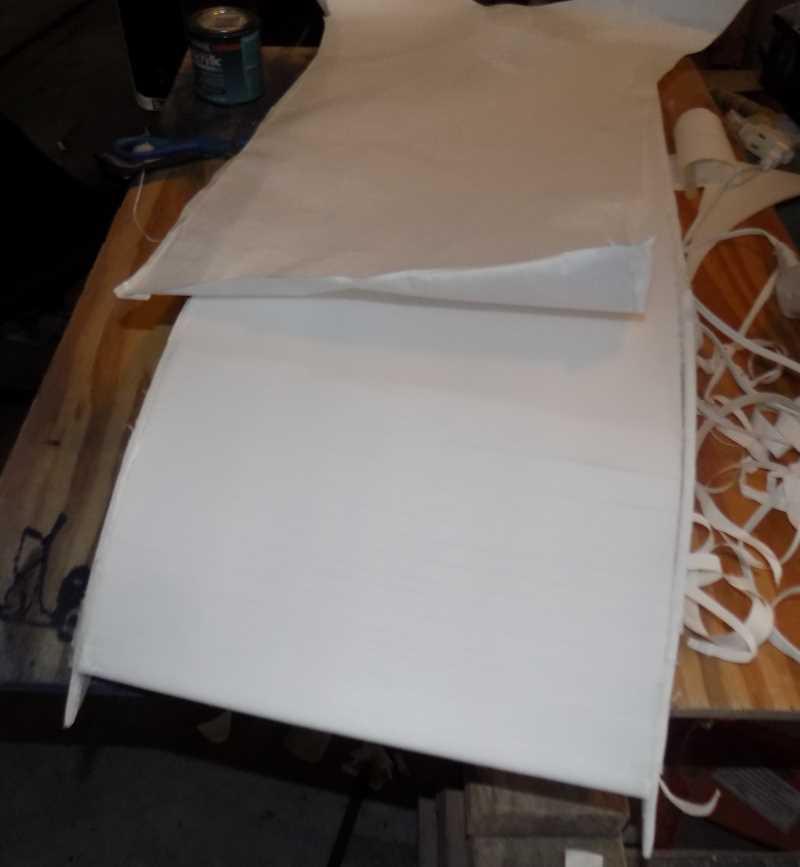 peeling paper off foamboard to prep for waterproofing