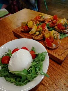 Italian cheese burrata and toasts with tomatoes