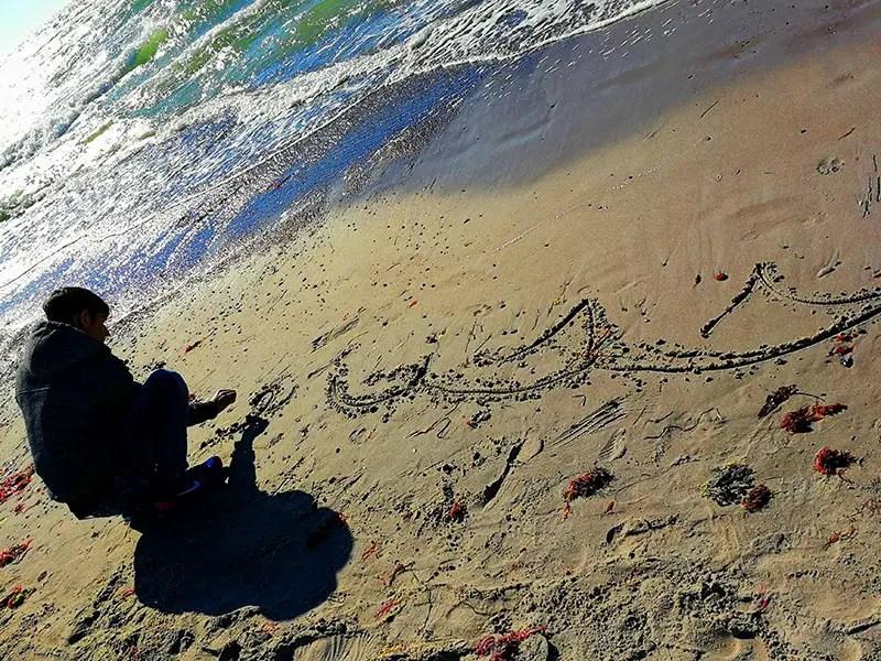 Schreiben im Sand