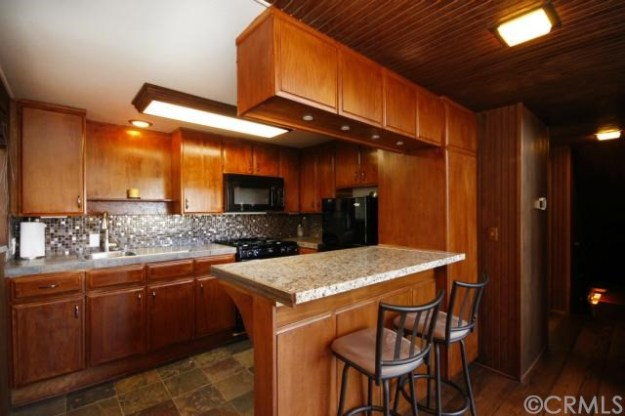 """My other complaint with this house is that the kitchen was obviously """"updated"""" but it totally doesn't fit in with the midcentury vibe of the rest of the place."""