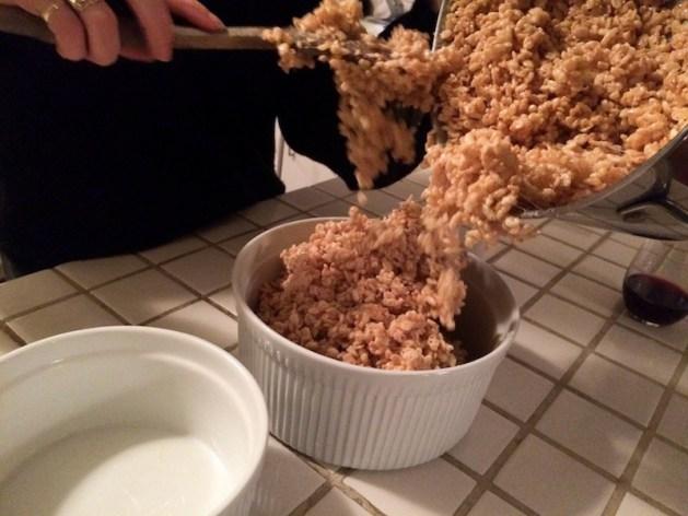 pour the Rice Krispie treat cake mix into a bowl