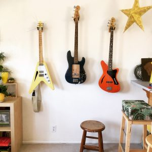 Three instruments on display: Sirena LaJara guitar, test bass with neodymium multi-coil sidewinder prototype, and a Sirena Modelo Uno