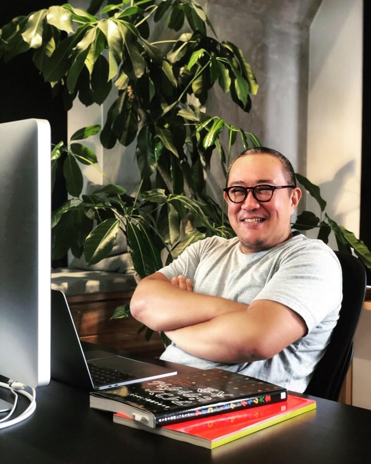 Web designer sitting at a Mac computer