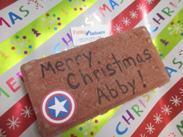 Merry Christmas Brick in the Mail