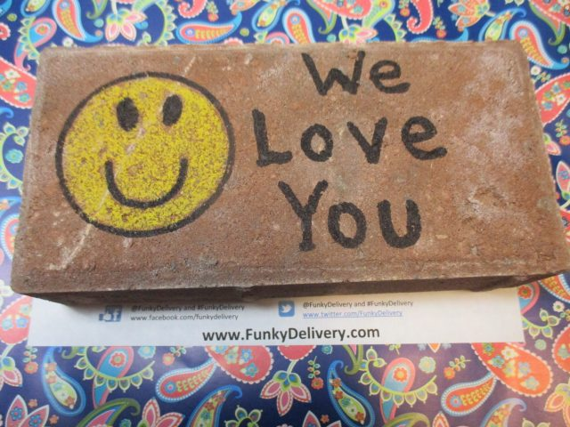 We Love You Brick in the Mail