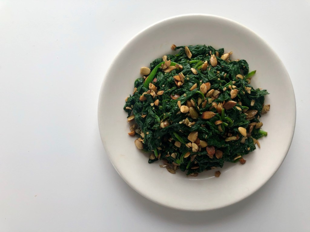 spinach salad with pumpkin seed oil