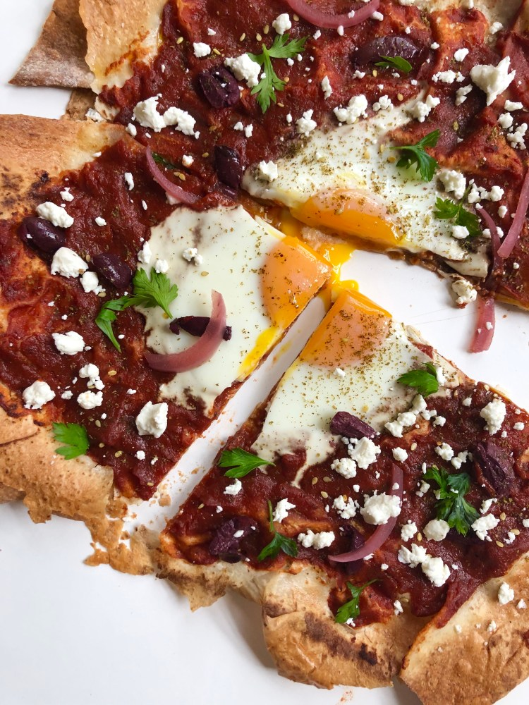 sliced markouk pizza recipe with an egg