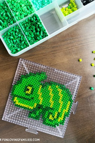 green chameleon made with melty beads