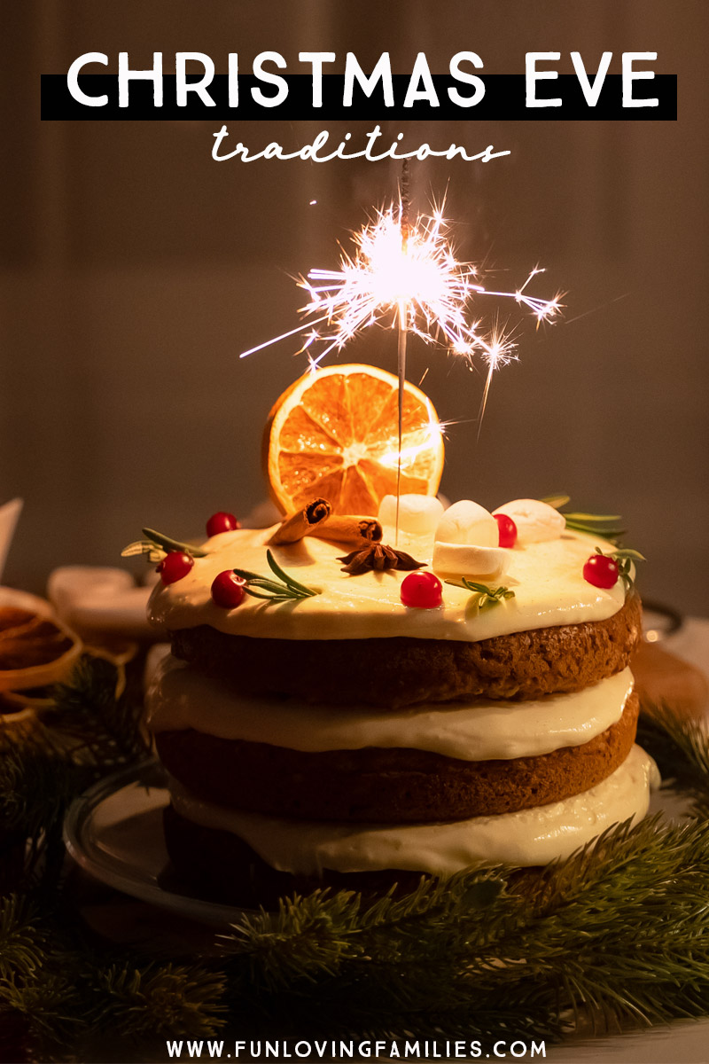 Christmas Eve traditions with festive layered holiday cake and sparkler