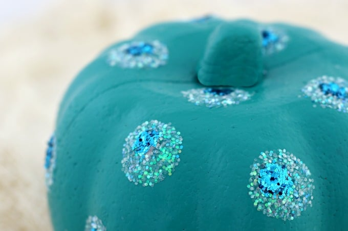 A little white glitter topped with blue gave our teal pumpkin a peacock look