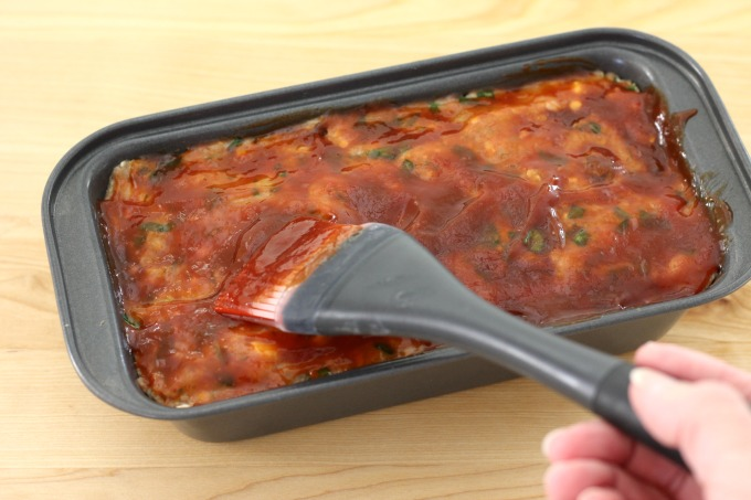 Top the turkey meatloaf with spinach with BBQ sauce