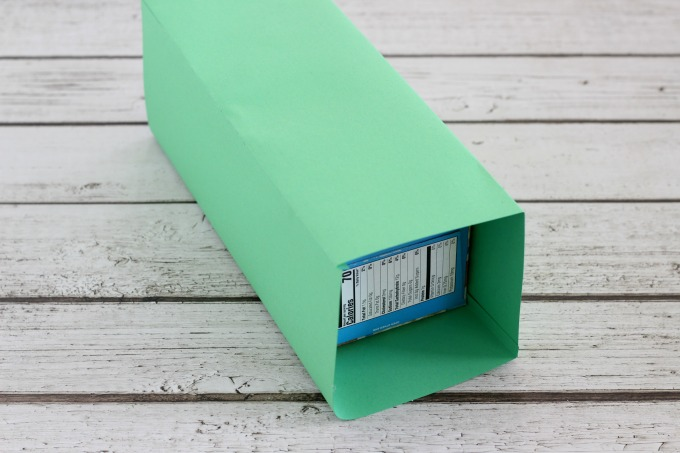 It'll take two pieces of construction paper to cover the sides and top of the leprechaun trap.