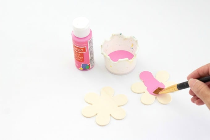 Painting wooden flowers pink for countdown board