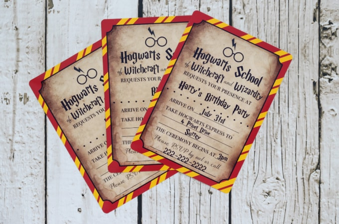 Harry Potter invitations on wood background