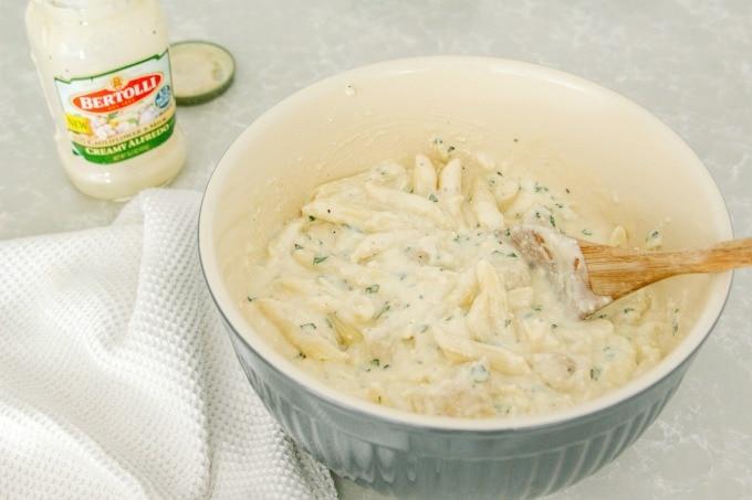 Combining ricotta mixture, Bertolli sauce and pasta