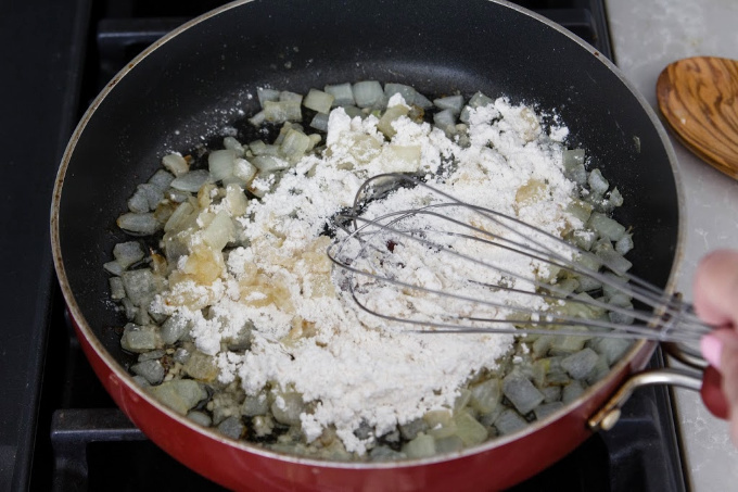 Whisking flour into sauteed onions