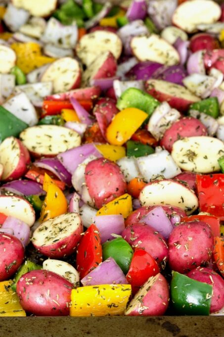 Potatos and vegetables on baking sheet