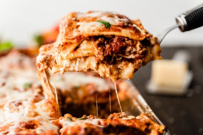 Homemade lasagna slice on a spatula