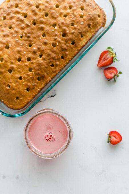 strawberry poke cake with holes