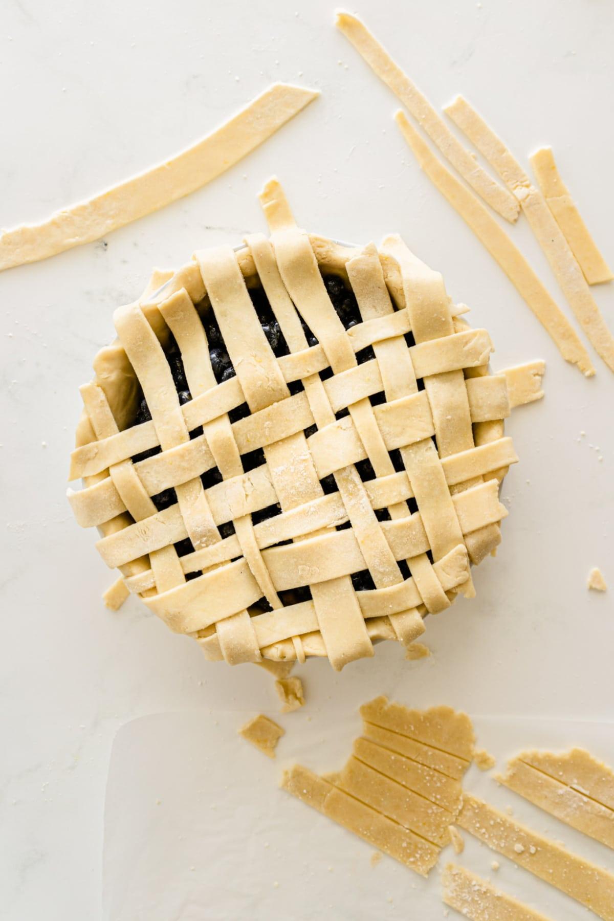 Making lattice crust for blueberry pie