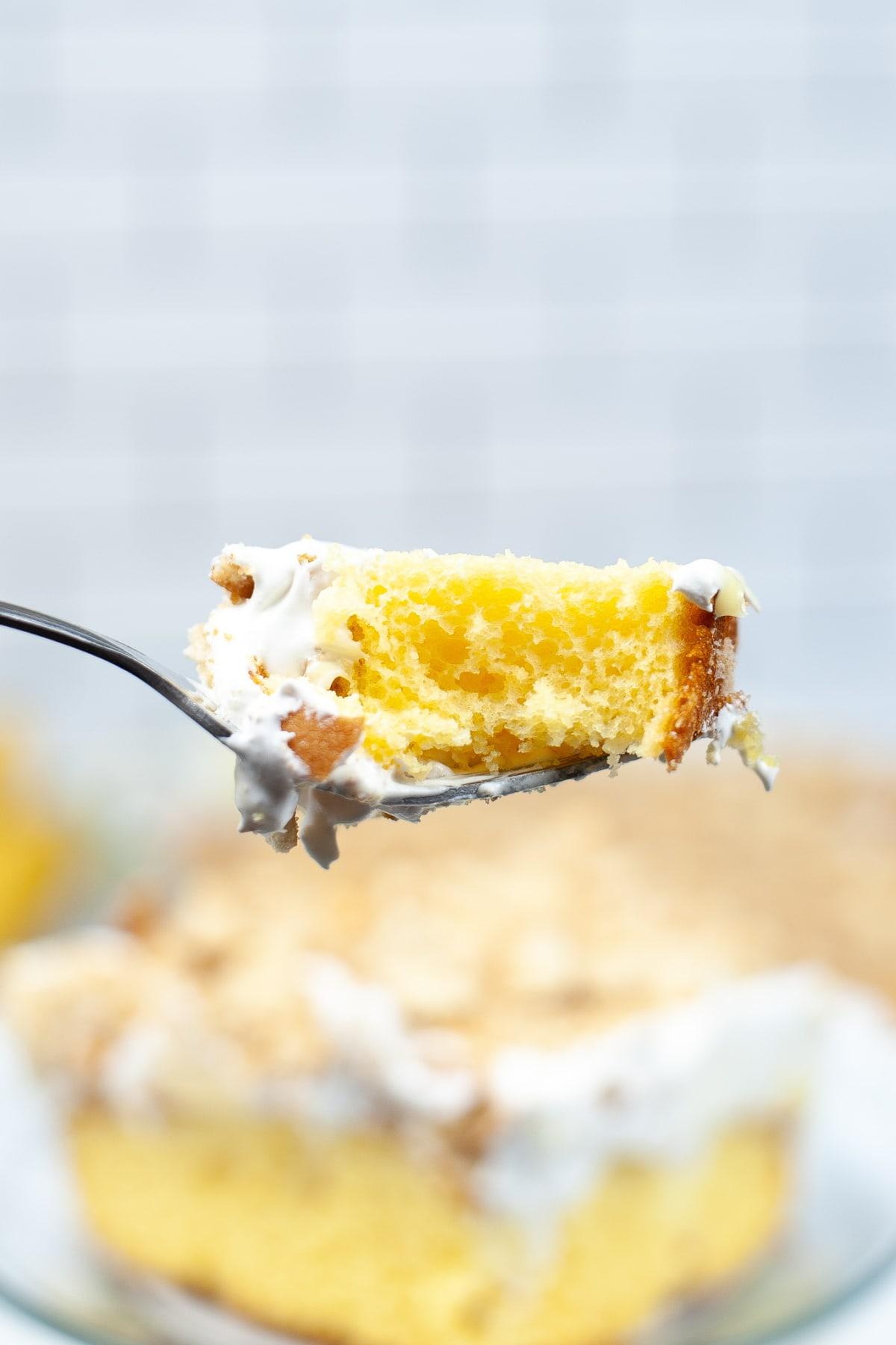 bite of banana pudding poke cake on fork