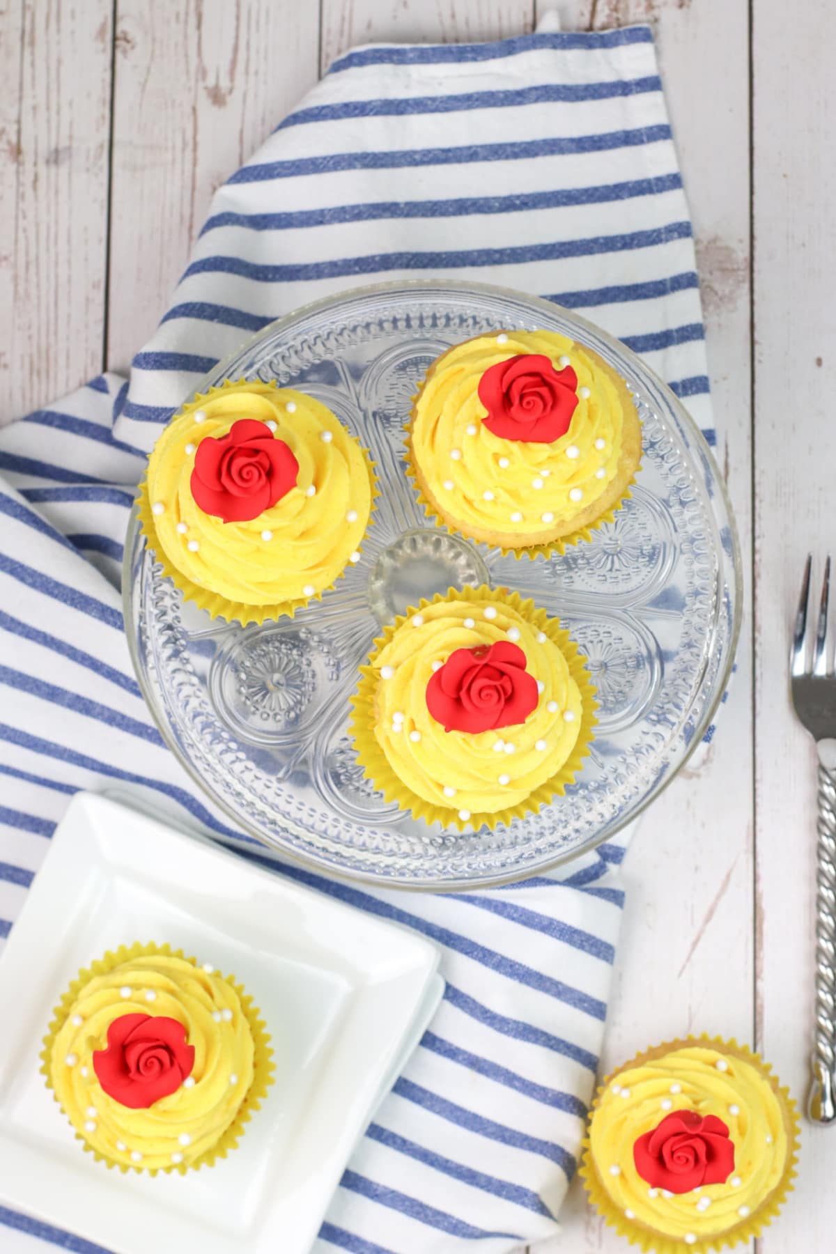 beauty and the beast cupcakes on striped towel