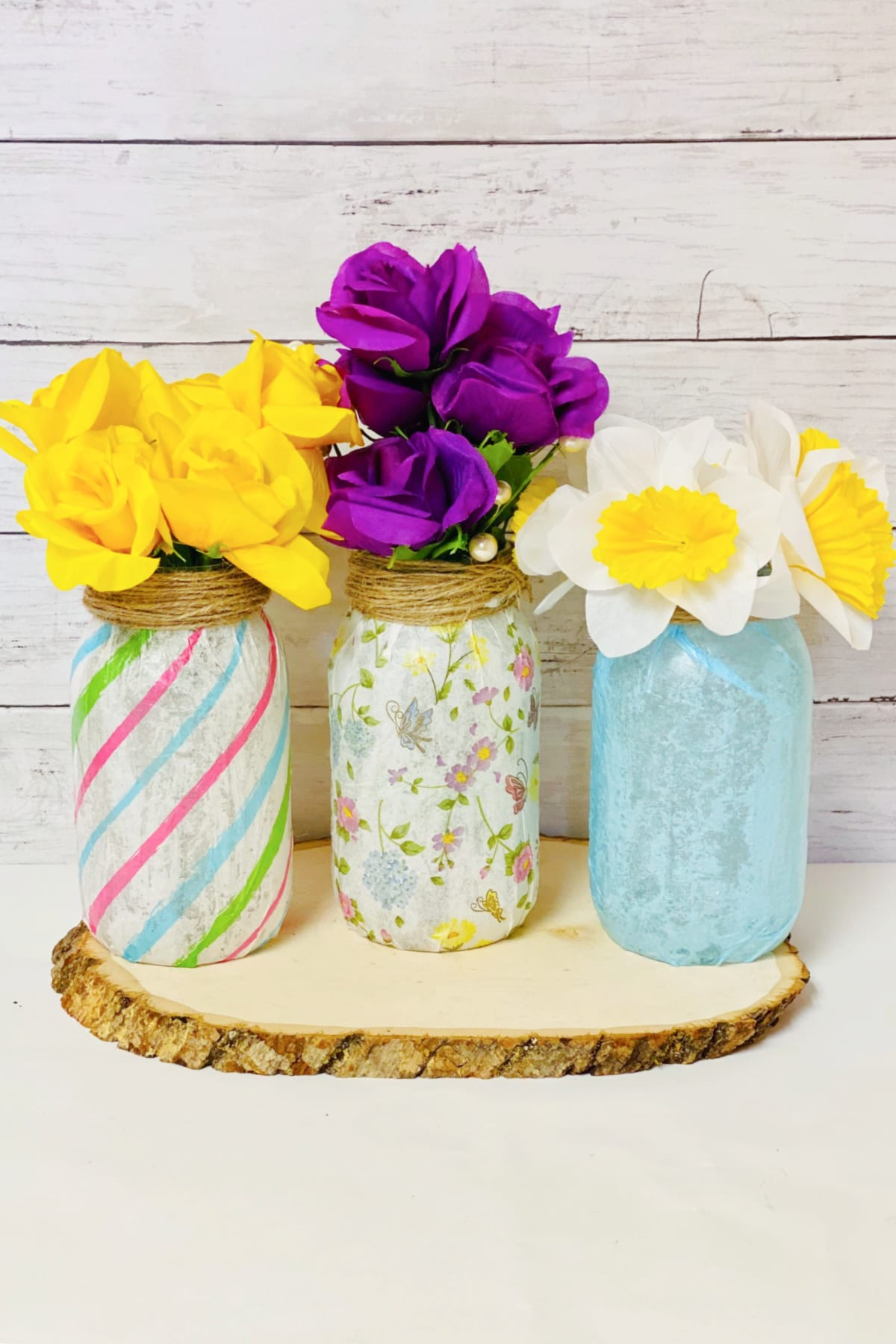 Mason jar vases with colorful flowers
