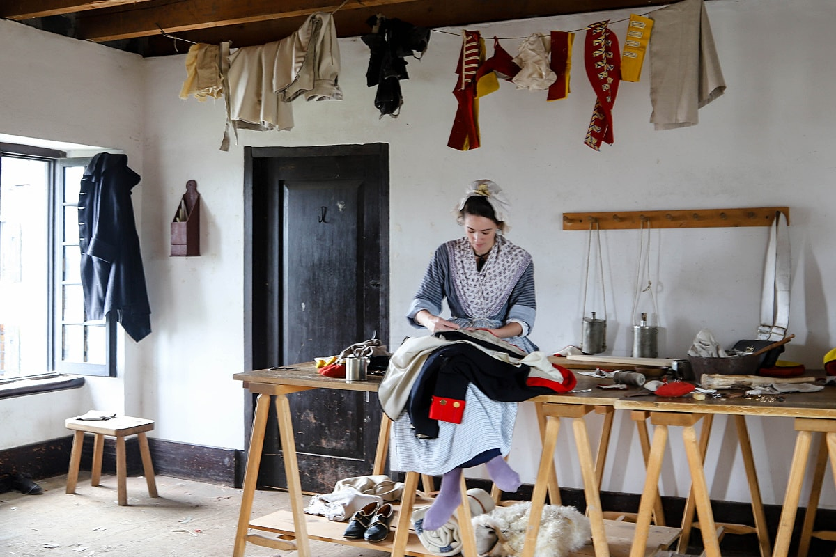 Tailor sewing uniforms at Fort Ticonderoga