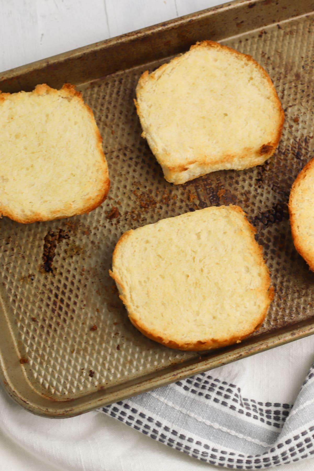 Sandwich rolls on baking sheet
