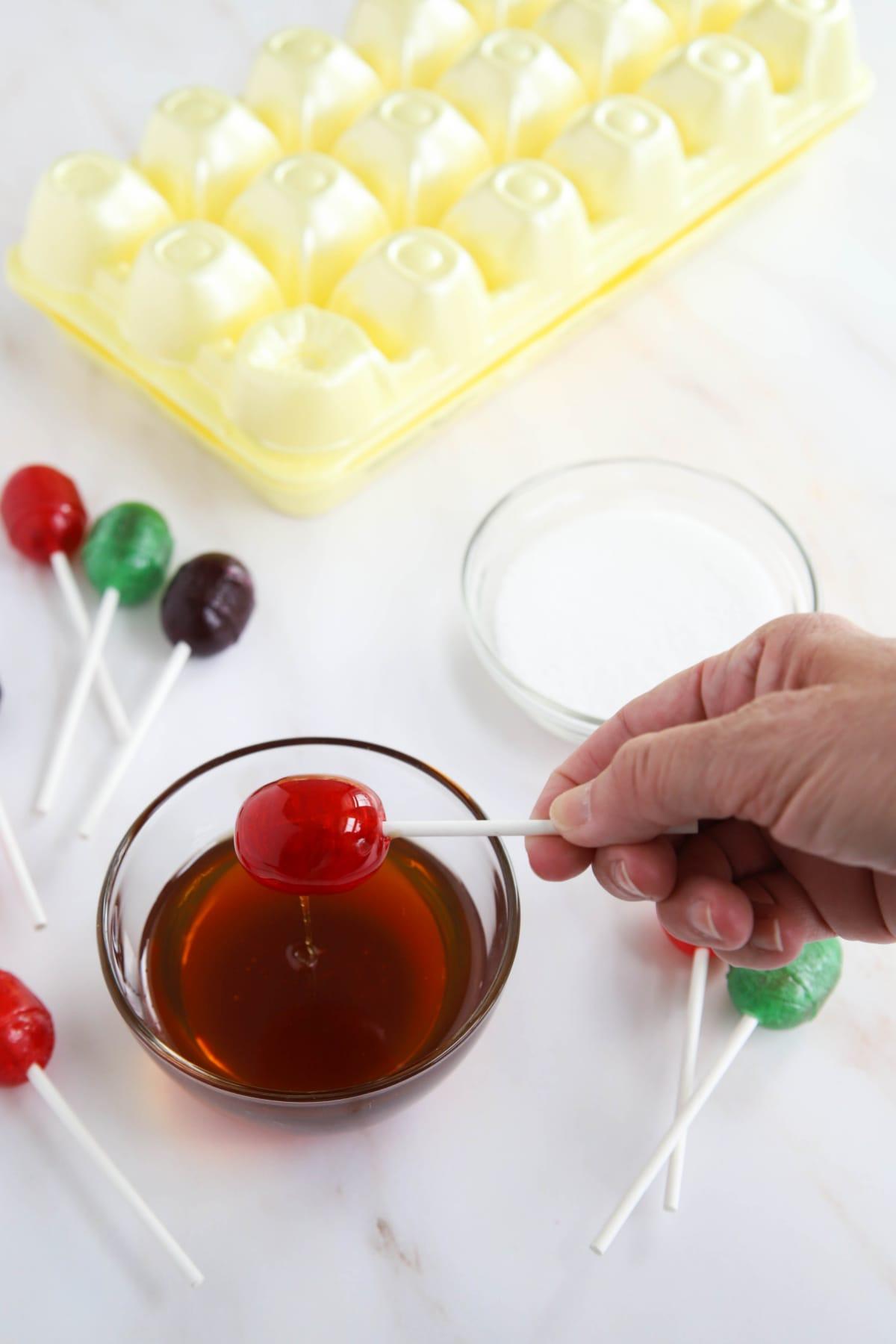 Dipping lollipops in honey