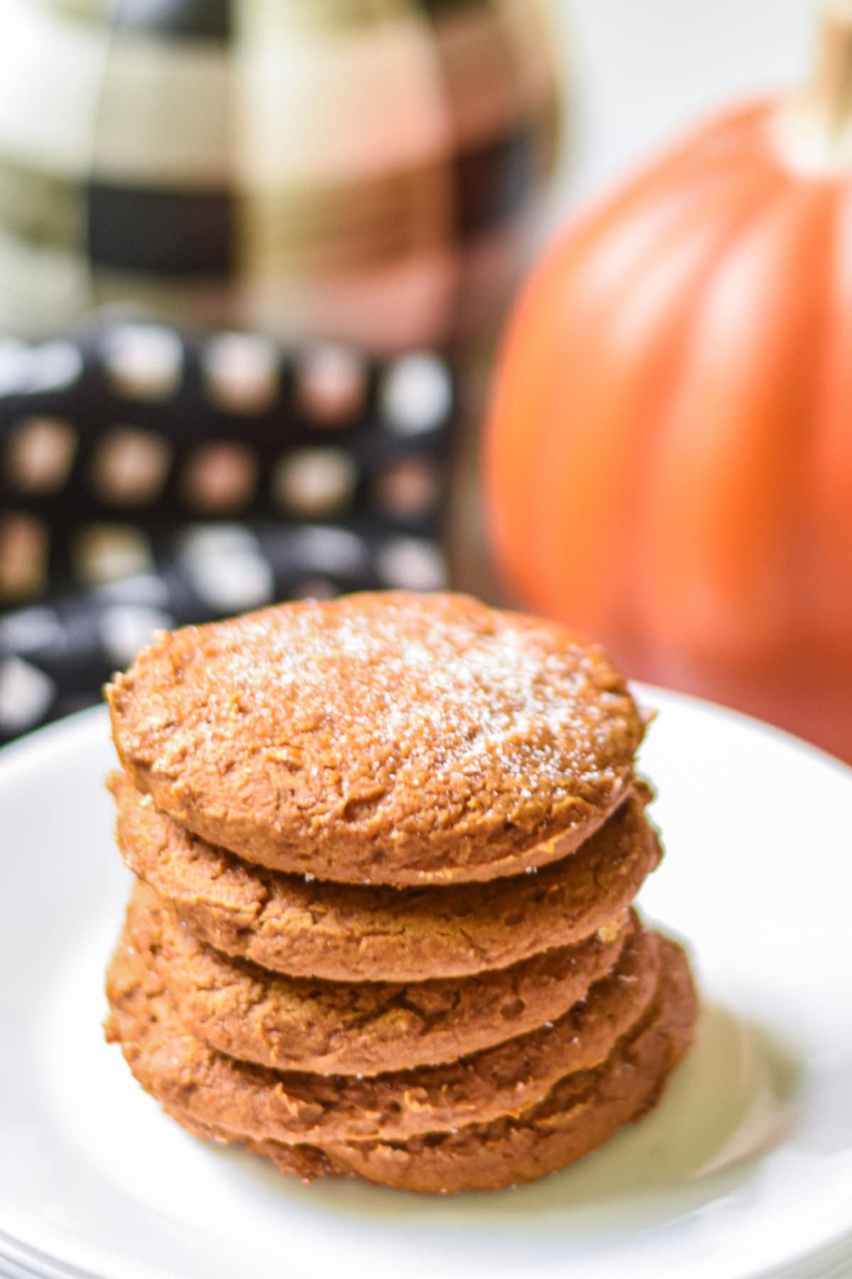 Pumpkin cookies stacked on plate