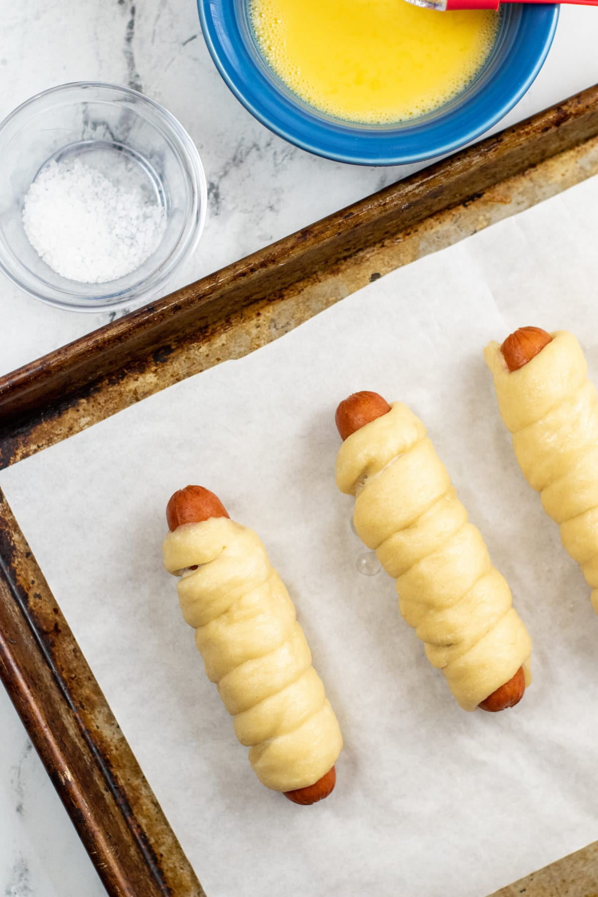 Hot dogs wrapped in pretzel dough