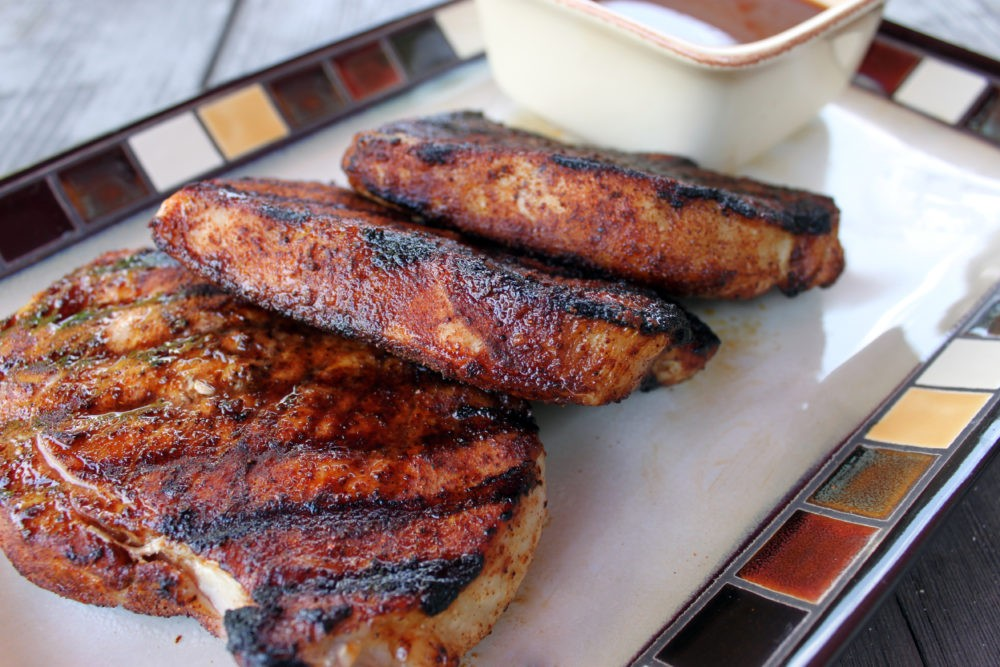 This North Carolina BBQ Pork Chops recipe is a quick, easy, and healthy dinner idea you'll love! Fire up the barbeque and make a meal your family will love! Don't forget the sauce!