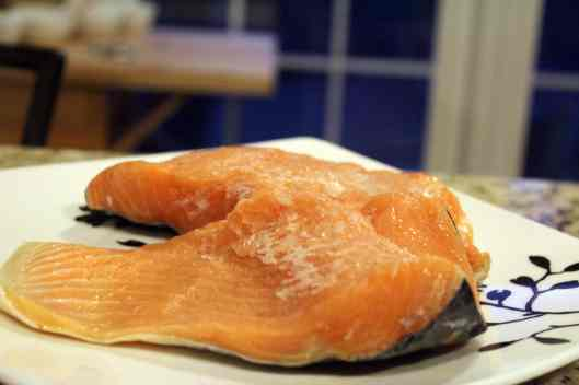 Let salmon filets thaw