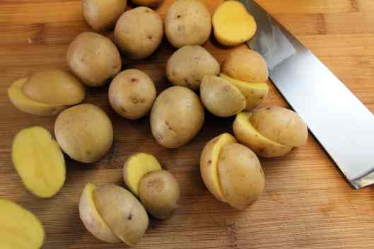 Cut potatoes in half