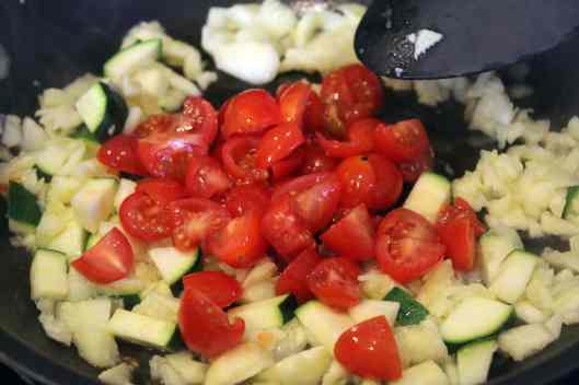 Add tomatoes to softened zucchini
