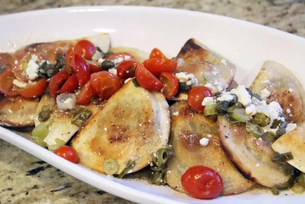 Pierogi topped with sauce