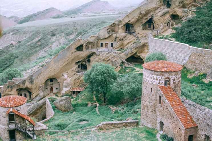 old stone structure in mountainous terrain