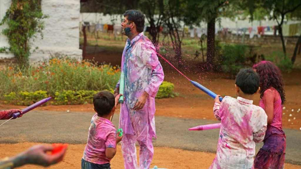 Children playing Holi with water Balloons and Water Guns