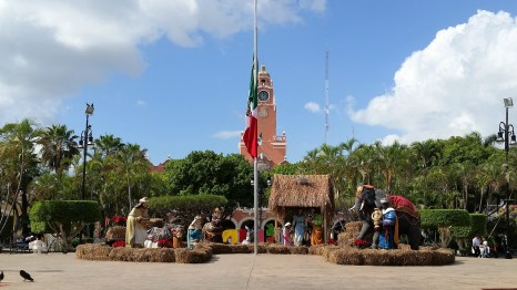 The manger in the center of town, conveniently backed by a colonial watchtower and the Mexican flag.