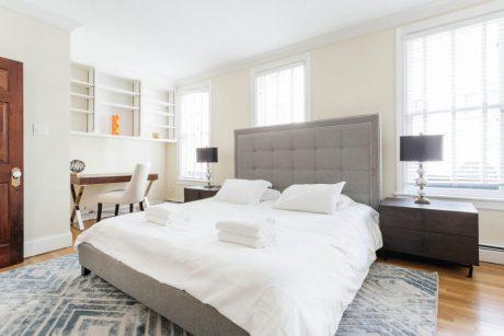 Luxury guest bedroom suite with desk