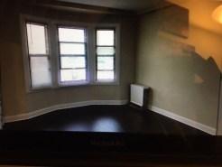 Empty and dark studio apartment, unfurnished
