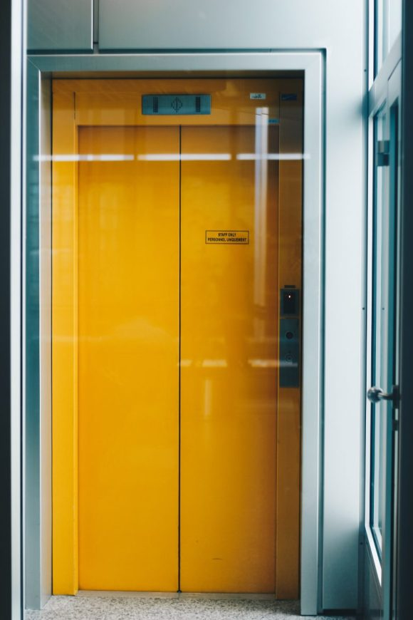 A closed yellow elevator