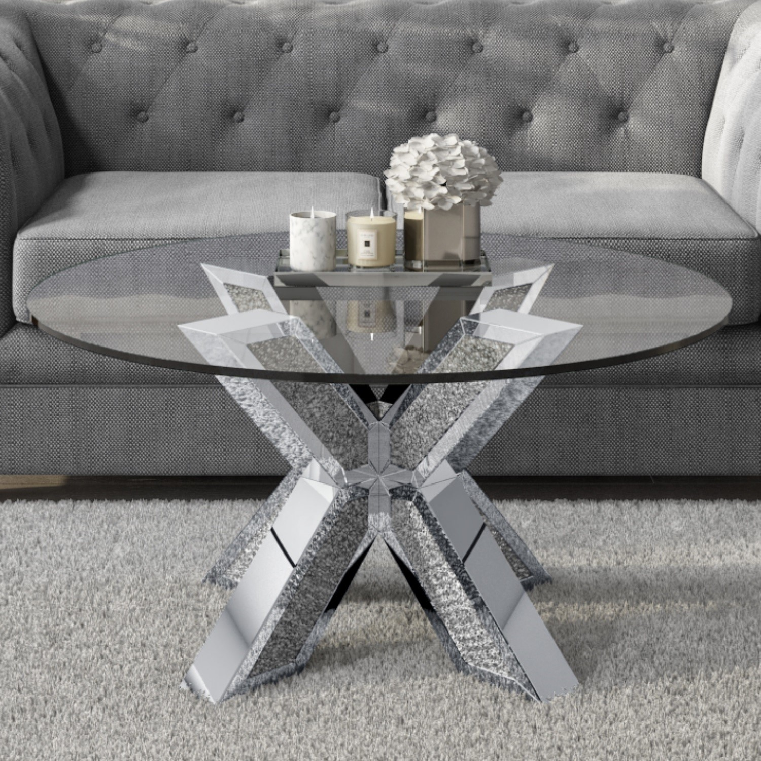 round coffee table with glass top and silver glitter base jade boutique