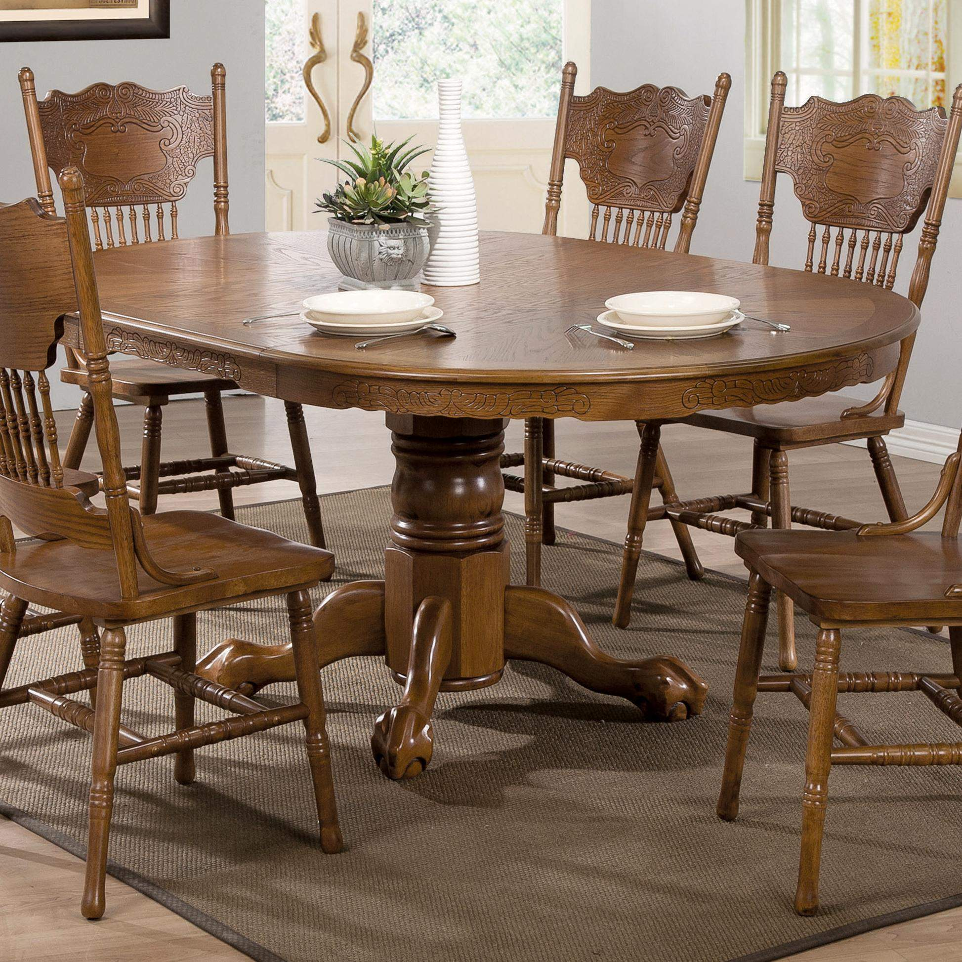 Brooks Oak Finish RoundOval Dining Table With Single