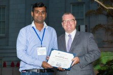 Altamash Kahn accepts the Tammy L. Blair best student paper award from Michael Moskal
